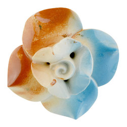 Knob Lovers - Amber Knob, 4 Knobs - Add some color to your home with this Amber knob! She is a one of a kind cream ceramic rosette knob with hand painted orange and blue detail. This blooming flower knob is set upon a gold mount and is beautifully finished.