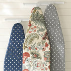PB Ironing Board Covers - In the whole laundry/cleaning rainbow, I'd have to say that ironing is my least-favorite activity. Though if I had an ironing board cover like this, I'd hate it less. I especially love the navy polka dot one.