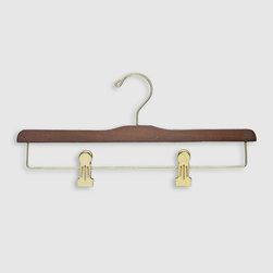 Frontgate - Set of Five Luxury Men's Trouser Hangers with Clips - Available in 100% birch wood or 100% maple wood construction. Clip hangers gently grab trousers at the cuff and hang them upside down; the weight of the garment actually pulls out wrinkles, thereby providing a soft press. Clip hangers can accommodate men's trousers, women's skirts, shorts, scarfs, and heavy-weight items. Safely hang your fine trousers without creating wrinkles or creases with our Luxury Men's Trouser Hangers. This hanger will grip your trousers without the risk of damage caused by ordinary locking-bar trouser hangers. Free up closet space and extend the life of your most important wardrobe items.  .  .  .