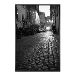 """Michal Venera Framed Print, Streets of Rome II, No Mat, 28 x 42"""", Black - On first glance, these iconic images of Rome are striking for their lush sepia tones, rich detail and intriguing camera angles. A closer look reveals the beauty of patterns, whether it is hundreds of stones that make up an old street, arches in the coliseum or the remaining three columns of a ruin. All exude a sense of order and timelessness amid the ever-changing landscape of city and country. 11"""" wide x 13"""" high 16"""" wide x 20"""" high 28"""" wide x 42"""" high Alder wood frame. Black or white painted finish; or espresso stained finish. Beveled white mat is archival quality and acid-free. Available with or without a mat.{{link path='shop/accessories-decor/pb-artist-gallery/artist-gallery-michal-venera/'}}Get to know Michal Venera.{{/link}}"""