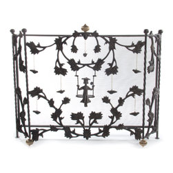 Mrs. Powers Fireplace Screen | MacKenzie-Childs - Get ready for cozy nights by a crackling fire. Playful and charming, our Mrs. Powers Fireplace Screen is sure to bring some extra warmth and cheer to any hearth, featuring a swinging lass with a jaunty hat and an eternally sunny disposition. Wrought of forged iron in a rich black-brown finish.
