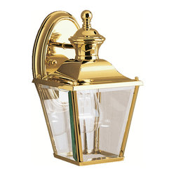 Kichler 1-Light Outdoor Fixture - Polished Brass Exterior - One Light Outdoor Fixture. The bay shore collection takes the classic lines of outdoor lanterns and dresses it up in style. Each piece in the bay shore collection features Kichler's exclusive lifebrite polished solid brass, which is guaranteed for a lifetime to look fantastic while being capable of withstanding the harshest elements no matter where you live. Clear beveled glass panels complete the bay shore outdoor lanterns' timeless profile. This 1-light hanging wall lantern uses a 100-watt bulb, is 10 high, and is UL listed for wet locations.