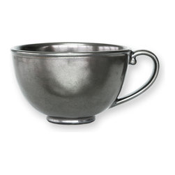 Pewter Stoneware Tea / Coffee Cup - Generously sized, the Pewter Stoneware Tea/Coffee Cup holds a steaming caf� au lait or a soothing English tea. The lustrous pewter finish adds glamour to a holiday table or a bit of European panache to a more casual dinner setting. The gently curved handle lends refined charm to the simple yet sophisticated silhouette.