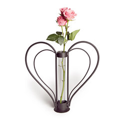 Danya B. - Swetheart Iron Heart Shaped Bud Vase - Show the strength of your love with this rustic iron sweetheart-shaped vase. The removable, recycled glass cylinder makes cleaning a snap, and the curves of the heart create useful handles. Love is more than just words, and this lovely vase is a creative way to bring your feelings into the physical world.