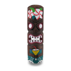 Zeckos - Green Partying Tiki Mask Hand Carved Wood Cocktail Tiki 19 in. - This incredibly realistic hand-carved partying tiki mask will add the perfect touch to any Polynesian themed room or tiki bar Each mask is handcrafted by artisans in Indonesia of Albesia wood, which is lightweight and easily replenished. It measures approximately 19 inches tall, and 5.5 inches wide (48x14 cm) with an attached hanger on the back. This fun tiki wears a green outfit, a flowery headdress and has an adult beverage in hand It's the perfect accent for a tiki themed room or island oasis sure to keep the party rolling, and makes a great housewarming gift NOTE: Because these masks are handcrafted, they may differ slightly than the one pictured.