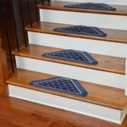 "Dean Flooring Company - Washable Non-Skid Carpet Stair Treads - Navy Blue Checkerboard (13) - Washable Non-Skid Carpet Stair Treads - Navy Blue Checkerboard (13) : Washable non-skid carpet stair treads by Dean Flooring Company. Helps reduce slips on your hardwood stairs. Great for helping your dog easily navigate your slippery staircase. Nylon pile with a machine washable non-skid latex backing (wash on delicate in cold water, line dry). Also easy to spot clean or vacuum. Reduces noise. Reduces wear and tear on your hardwood stairs. Each set contains 13 pieces. Each tread is approximately 22.5"" x 10"". Easy DIY installation with double-sided carpet tape (not included). Adds an attractive fresh new look to your staircase."