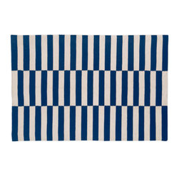 Navy Buche - This rug is definitely on the pricier side of flatweave rugs. But it's a classic pattern from the amazing collection of Madeline Weinrib. This navy-and-white beauty will never go out of style.