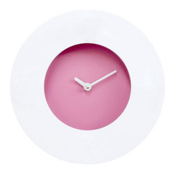 Progetti - Doughnut 2305 White/Purple Wall Clock - Doughnut is a wall clock that reminds us, both in name and in its shape, of doughnuts. Born from the pencil of the Japanese designers Shinichi Yamauchi and Kei Ninomiya, it recaptures the harmonious and clean lines that are typical of oriental culture by creating a simple object but at the same time with character, and with the distinctive trait of being customizable. In fact, the outer dial, which is white, is magnetic and it is thus possible to attach metal objects to it. This feature makes every Doughnut unique. Anyone, even children, may customize their own clock, having fun in creating endless different dials that differ depending on the season or where it is positioned, in the kitchen, in the living room, in the office, in the bedroom, etc; or you can create an alternative coin tray for example, by applying paper clips, cookie cutters, hair clips and much more, unleashing one�۪s creativity at any given time. The metal dial is magnetic and always white in color while the box, which is made of plastic and wood, is available in pink or green. Battery quartz movement.