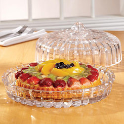 Fifth Avenue Crystal - Fifth Avenue Crystal Alexandria Domed Cake Plate - This crystal domed cake plate would make a beautiful addition to your cookware. Its sparkling glass appearance is only the beginning of its beauty. This is a functional piece that can be used to display your favorite desserts or quiche.