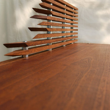 "Straight and Arrow Desk - Philippine Mahogany with hex nut spacers in between wood slats.  Angled slats create a faux backsplash.  Hidden steel base with wheels make the table mobile.  Dimensions 60""W x 31""H x 20""D.  Hand made by KILLSTRESS Designs™ in Costa Mesa, CA."