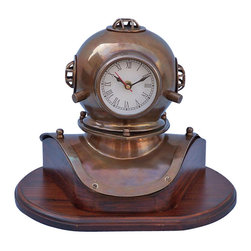 Handcrafted Nautical Decor - Antique Brass Divers Helmet Clock on Wood Base 12'' - --The Hampton Nautical Antique Brass Diver's Helmet Clock on Rosewood Base 12'' is great nautical Decor and sits well on areas such as a desktop or a mantle. The diver's helmet, featuring a working quartz clock, is an antique brass miniature of our bigger diver helmet. The Antique Brass Diver Helmet Clock rests nicely on a high quality solid hardwood base that has a polished finished. A blue felt is placed on the bottom of the diver helmet clock base so it can rest on any surface without damage.----    Antique brass helmet body--    Antique brass grills and fittings--    Fully functional clock keeps accurate time (batteries not included)--    Solid hardwood base rests firmly on a desk, table,      or shelf--    Felt-lined footing protects furniture surfaces----