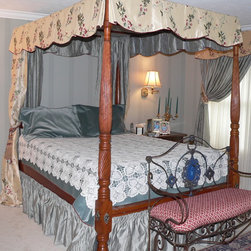 Canopy four poster Tester bed - This Four poster tester bed was crowned with a contrast lined box pleated scalloped welted bottom valance, drapery at the head of the bed and a contrast shirred bed skirt.  Window has full drapery swept up in tie back and topped with valance to match one on bed.