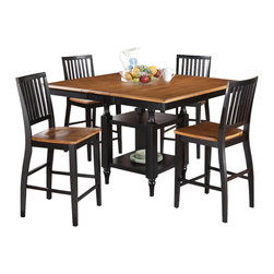 """Steve Silver Furniture - Steve Silver Candice 5-Piece Square Counter Table Set in Oak and Black - The Candice collection offers country-style simplicity, transforming any dining area into a charming sanctuary. The black and oak Candice counter table features a 12"""" butterfly leaf and is supported by a square base with shelves for storage or display. The table measures 54""""W x 42""""L without the leaf and 54""""W x 54""""L with the leaf in place. Add the Candice black and oak counter chairs and you can comfortably seat eight!"""