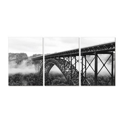 Elementem - Bridge in the Clouds Wall Art | Elementem - Design by Elementem Photography. Bridge in the Clouds is a photograph of a bridge in West Virginia which is one of the longest single arch bridges in the world. Shown set amidst the clouds in black and white, Bridge in the Clouds has an ethereal quality. Bridge in the Clouds is digitally printed on vinyl then mounted onto solid wooden MDF frames and covered with a thin layer of laminate that allows the print to be easily cleaned with Windex and water. All the wall hanging materials needed for installation are provided. Suitable for contract projects. Available in three size formats.Elementem Photography is a proud member of 1 Percent for the Planet, a group of businesses that have committed to donating 1 percent of their sales towards environmental causes.