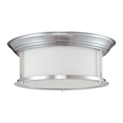 Three Light Brushed Nickel Matte Opal Glass Drum Shade Flush Mount - This three light lamp, with a brushed nickel finish and matte opal glass rests against the ceiling and is a perfect fit in a modern home.