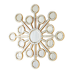 Orion Mirror - Geometry and glamor come together through the rounded forms and radiant lines of the Orion Mirror, giving reflective flash to a wall decor piece that assembles simple forms into a complex design that draws on runic motifs for its high impact.  This mirror makes a dazzling addition to a gallery wall, especially across from a window where it can increase a room's illumination.