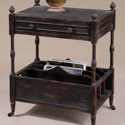 None - Phineas Magazine Table - Painted slate black with red undertones and rub-through distressing. Table has four vertical slots for books,French dovetail drawer,carved finials,and antiqued Castors.