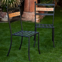 Coral Coast Terra Cotta Mosaic Bistro Chairs - Set of 2 - Pair a Terra Cotta Mosaic Bistro Table with the Coral Coast Terra Cotta Mosaic Bistro Chairs - Set of 2 and you'll have the perfect spot to enjoy al fresco dinners in style. Hand-laid, deep rust colored terra cotta tiles with charcoal grey grout give a unique look to the backrest, while enhancing the beauty of black powder-coated, rust-resistant iron frame. Not to be outdone in comfort, the lattice seats will envelope you and a friend in luxury all through your meals. Though this set of chairs is designed primarily for outdoor use, it also makes a perfect addition to your kitchen corner. This set of chairs is virtually maintenance-free - simply hose off to clean and wipe dry with soft cloth. We recommend storing this set indoors or in a garden shed or garage to prolong life because grout will expand and crack if left out in freezing conditions. Do not use harsh chemicals. While bistro chairs of this quality usually sell for more than twice the price at specialty stores, we offer the same hand-crafted quality and fun, fresh mosaic pattern at a fabulous price, so you can make the most of your summer without spending a bundle! Please note: Each piece is hand-crafted and might vary slightly from the design seen in the images.About Coral Coast What if, when you closed your eyes, you pictured yourself in your own backyard? Coral Coast has a collection of easygoing, affordable outdoor accessories for your patio, pool, or backyard. The latest colors and styles mingle with true classics in weather-worthy fabrics and finished woods, ready for relaxation. Make yours a life of leisure.