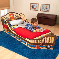 KidKraft Pirate Toddler Bed - Let him live the life of the tiny pirate he wants to be while dreaming in his very own KidKraft Pirate Toddler Bed. Fun and colorful, this transitional bed makes the move from the crib to an adult bed way more fun! Crafted of sturdy composite wood and molded plastic, this bed sports safety rails and a low profile, making it easy to get in and out. The adorable artwork is sure to be a hit as is the hidden storage at the foot of the bed - the perfect place to hide all his treasures! A mattress, bedding, and pillows are sold separately, but this bed does fit most crib mattresses for your convenience. Step-by-step assembly instructions included.About KidKraftKidKraft is a leading creator, manufacturer, and distributor of children's furniture, toy, gift and room accessory items. KidKraft's headquarters in Dallas, Texas, serves as the nerve center for the company's design, operations and distribution networks. With the company mission emphasizing quality, design, dependability and competitive pricing, KidKraft has consistently experienced double-digit growth. It's a name parents can trust for high-quality, safe, innovative children's toys and furniture.