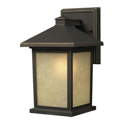 One Light Oil Rubbed Bronze Tinted Seedy Glass Wall Lantern - The solid, timeless styling of this medium outdoor wall mount makes this a versatile fixture, suiting both traditional and modern styles.  Warm tinted seedy glass panels are paired with a finish of oil rubbed bronze, to create a very inviting look. Made of cast aluminum, this fixture is made to endure nature, regardless of the season.