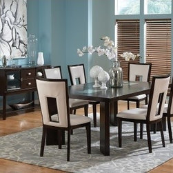 Steve Silver Delano Side Dining Chairs - Espresso - Set of 2 - Whether they're part of a casual or elegant dining room, the Steve Silver Delano Side Dining Chairs - Espresso - Set of 2 are brimming with contemporary charm. The wood legs and frame are finished in a rich, multi-step espresso, while the white vinyl upholstery creates a comfy contrast. Plus, rectangular cutout backs add that perfect hint of mod allure. Pair with your own dining set or other pieces in the Delano dining collection.About Steve SilverSince its founding in Forney, Texas, in 1987, the Steve Silver Company has had a simple focus: to provide the best quality product at an irresistible price, back it up with uncompromising service, and continue to improve every day. As one of the premier suppliers of dining sets and occasional furniture in the country, Steve Silver is proud to make you, the customer, its top priority, utilizing state-of-the-art equipment, proven operating procedures, and over 500,000 square feet of facilities. You'll feel equally proud displaying furniture from the Steve Silver Company in your home.