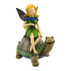 Fairy Riding Turtle Statue - This little golden haired fairy is hitching a ride through the forest on the back of her turtle friend. The statue is made of cold cast resin and measures 8 3/4 inches tall, 7 1/2 inches long, and 5 1/2 inches wide. It is hand painted, and makes a lovely addition to fairy art collections.