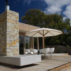 Modern Porch by Altereco Design