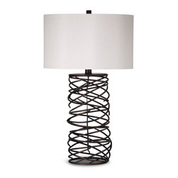 Bassett Mirror - Whittier Table Lamp - An open spiral cage design turns this striking lamp into a work of art. The Whittier Table Lamp features a crisp white drum shade and thin metal spiral base in bronze finish. A perfect complement to both bold and neutral color schemes, this lamp makes a unique and eye-catching addition to any contemporary decor. Requires 60 watts or less, bulbs not included.