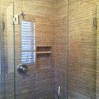 "Frameless Shower Doors, Frameless Glass Enclosures - Custom fully frameless shower enclosure using 3/8"" PPG Starphire low iron glass.  Arch pull handle.  Headerless design for ultra modern, clean look."