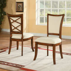 Riverside Furniture - Windward Bay Dining Side Chairs - Set of 2 Multicolor - RVS2336 - Shop for Dining Chairs from Hayneedle.com! Elegant and a little flirty the Windward Bay Dining Side Chairs - Set of 2 is a graceful place to seat your dinner guests. This set includes two chairs crafted of hardwood solids and birch veneers in a lightly distressed warm rum finish. The chairs feature cushioned seats and backs upholstered in a fresh ivory fabric. From the back you can see a double criss cross design.Notes on Riverside ConstructionAll Riverside domestic furniture is constructed of fine oak ash poplar and pine wood. These wood types are durable and feature beautiful open grains that make them much preferred among furniture manufacturers. Each piece of wood is first graded for quality then kiln-dried to remove excess moisture and prevent splitting. The wood is then constructed into a high-quality furniture piece using a combination of hardwood solids and hand-selected veneers. Techniques used on Riverside pieces include dovetail joinery heavy-duty drawer roller guides and multi-step finish applications that include hand-sanding and polishing for a deep lustrous result. All Riverside furniture is given this high-quality treatment to ensure the beauty and durability of your final product.About Riverside FurnitureRiverside has been growing for more than half a century. The company's founder Herman Udouj opened the doors to his first factory in 1946 and along with 12 employees he began making handcrafted furniture for the post-World War II Baby Boom era. Since then generations of customers have furnished their homes and offices with Riverside's wide range of furniture products. Riverside strives to be trusted for quality products that are an affordable value. It's just that simple.