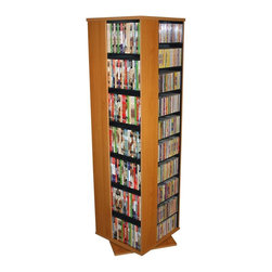 Venture Horizon - Revolving Media Tower w 4 Sides in Oak Finish - Perfect for music and movie buffs, this four-sided revolving media tower will be an excellent addition to any decor. Featuring spaces for all types of media including CDs, DVDs, blu-ray discs, VHS tapes and more, the tower is finished in oak and will be a great way to keep your collection organized and easy to access. Rotates 360°. Huge storage capacity. Organizes all media. Constructed from durable, stain resistant and laminated wood composites that includes MDF. Made in the USA. Assembly required. Media storage capacity:. CD's : 1160. DVD's : 560. Blu-ray's: 716. VHS tapes: 308. Disney tapes: 230. Audio cassettes: 1100+. Weight: 95 lbs.. Shelf depth: 6 in.. Assembled size: 19.25 in. W x 19.25 in. D x 63 in. HOrganize an entire media collection. These 4 sided beauties will brighten up any room. Because they rotate a full 360°, you will never have to strain your neck locating your favorite CD, DVD, video or cassette. There are 5 models from which to choose so identifying the perfect match should be easy. Nearly all the shelves are adjustable so even odd sized media like Disney Tapes can be accommodated. Constructed from durable melamine laminated particle board these towers are stain resistant and easy to clean. The front panels and top/bottom panels on Models: 2021, 2022, 2381, 2391 and 2392 are gently molded and stylishly contoured to add real value. NEW! We just added a 2 sided Revolving Media Tower available in 2 sizes and 4 colors.
