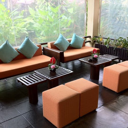 Rummana Boutique Resort - This is an Asian Contemporary reception area for a local Resort. We recovered all the Love Seats and sitting stools to match the Resort theme color.