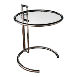 """Matrix International - Eileen Adjustable Side Table - This adjustable table was designed as a bedside breakfast table for the guest room of E-1027, the villa which Eileen Gray and Jean Badovici designed at Roquebrune in 1927. The top is 1/4 inch clear glass. The frame is constructed of chrome-plated tubular steel with welded endcaps. Height is adjustable at various intervals from 24"""" at the lowest setting to 39"""" at the maximum height."""