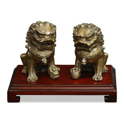China Furniture and Arts - Hand Forged Bronze Foo Dogs - Always standing in pairs, Foo Dogs are fantasy lions in Chinese mythology who serve as guardians to prevent harmful things from happening to the family. This handsome pair are standing in commanding posture. The male, with a paw on a symbolic ball, protects the world, while the female, with a paw on a cub, protects the dwelling. This handsome pair is hand forged silver by artisans in China with fine detail. Wooden stand sold seperately.