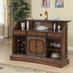 Bar Unit - This sophisticated traditional bar will be a welcome addition to your home. Finished in a rich warm medium wood tone, this piece will blend beautifully with the decor in your entertainment room. Fluted columns and carved details at the corners are elegant, with a smooth dark marble top for the ultimate in luxury. A faux wicker panel on the front of the bar adds a touch of casual appeal too, making this bar the perfect choice for your home. A generous work surface, two storage doors with enclosed storage space inside, a wine rack, and a stemware hanging rack offers everything you need to stay organized while entertaining friends. Pair with the matching bar stools for a complete ensemble in your entertainment room.