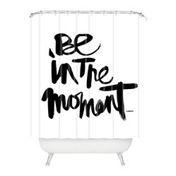 Kal Barteski Be In The Moment Shower Curtain - When you are caught up in your day and need a moment of quiet reflection, this shower curtain's bold, hand-scripted reminder will stop you in your tracks. The elegant ink brush writing and simple black on white design is a nod to contemporary minimalism, giving space and silence to the message despite its prominent presence.