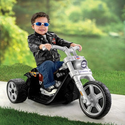 Fisher-Price Inc - Fisher-Price Power Wheels Harley Motorcycle Battery Powered Riding Toy - Black - - Shop for Tricycles and Riding Toys from Hayneedle.com! If your busy little ones haven't already proven they're born to be wild from time to time they will once they step onto the Fisher-Price Battery Powered POWER WHEELS Harley-Davidson Black Rocker. The cool child-size Harley-Davidson motorcycle is based on grownup counterparts but tricked out with loads of kid-friendly features. The ultimate experience though is every bit as hip. Dimensions: 27L x 25W x 15H inches. Weight capacity: 50 lbs. Ideal for ages 18 months-4 years. This kid size black Harley is crafted from durable plastic and outfitted with an easy push-button operation mechanism a stable 3-wheel design with a low rider base for easy access on and off a clicking speedometer dial and a Harley-Davidson Rocker-inspired solo seat. The included six-volt battery and charger power up the motorcycle's 2 mph speed. The Harley can be driven on both hard and grassy surfaces too so no area of the yard is off-limits. As the most trusted name in quality toys Fisher-Price has been helping to make childhood special for generations of kids. While they're still loved for their classics their employees' talent energy and ideas have helped them keep pace with the interests and needs of today's families. Now they add innovative learning toys toys based on popular preschool characters award-winning baby gear and numerous licensed children's products to the list of Fisher-Price favorites.