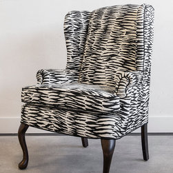 """Vintage Wingback in New Trina Turk Fabric - """"Zelda displays classic Queen Anne style cabriole legs ending in a clean, rounded pad foot.  While her lines and form are decidedly traditional, her sophisticated cloak of abstracted zebra screams of champagne-doused twenties excess.  The black welt detail draws attention to her curves, amping up her sensuous quality, while the exceedingly straight lines of her back shows us there is structure and substance below.  Her new look is inspired by the deco era and by her namesake, the always elusive Zelda Fitzgerald, featured as many a heroine in her husband's novels."""""""