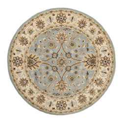 Safavieh - Safavieh Handmade Kerman Light Blue/ Ivory Gold Wool Rug (3'6 Round) - Adding traditional flair to your space is a snap with this round handmade wool rug. This rug features a classic floral pattern in softly muted colors,and it has a thick pile height so that your feet are comfortable when walking across the floor.