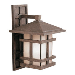 KICHLER - KICHLER 9131AGZ Cross Creek Arts and Crafts/Mission Outdoor Wall Sconce - With rustic charm as unique as its design, The Cross Creek Collection puts a modern spin on a classic fixture. Each piece is constructed from long lasting cast aluminum ensuring a quality fit and finish that will last for ages. Our Aged Bronze finish adds a distressed appearance to the piece, while Textured linen seedy glass panels additional warmth make the Cross Creek Collection the perfect balance of ambiance, style, and value. This one light wall lantern from the Cross Creek Collection uses a 150-watt (max.) bulb and is U.L. listed for wet location and comes with removable backplate.