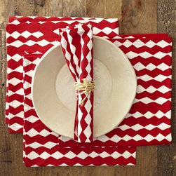 Diamond-Printed Napkin - For an eclectic touch, mix formal dinnerware with casual linens, like the diamond-printed napkins from West Elm. There's no need to be over-the-top fancy when celebrating with family and friends.