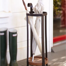 Blacksmith Umbrella Stand - Although I don't get much rain here in California, I do like to have a stylish place to keep the umbrellas.
