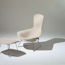 """Knoll - Bird Ottoman with Full Cover - With his iconic seating collection, Harry Bertoia transformed industrial wire rods into a new furniture form. The events that made this work possible began a decade earlier at Cranbrook Academy of Art when Bertoia met Florence Knoll Bassett (then Florence Schust). Years later, the Italian-born designer was invited to work for Florence and her husband Hans Knoll. Bertoia was given the freedom to work on whatever suited him, without being held to a strict design agenda, and the result of this arrangement was the Bertoia Seating Collection (1952). Featuring a delicate filigreed appearance that's supremely strong, these airy seats are sculpted out of steel rods. In his art, Bertoia experimented with open forms and metal work, and these chairs were an extension of that work. """"If you look at the chairs, they are mainly made of air, like sculpture,"""" said Bertoia. """"Space passes through them."""" After designing his seating collection, Bertoia returned to focusing mostly on sculpture. His work was often used in projects by Eero Saarinen (another Cranbrook friend), notably at MIT and the Dulles International Airport. Manufactured by Knoll according to the original and exacting specifications of the designer. Made in Italy. Frame made in Italy, cover made in U.S.A. Full cover is stretched over wire seat basket and attached to seat basket with hooks. The Bird Chair and Ottoman have been in continuous production since 1952. Frame is scratch, chip and chemical resistant. The Knoll logo is stamped into the base of the chair and ottoman."""