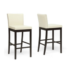 Wholesale Interiors - Graymoor Cream Modern Bar Stools, Set of 2 - A rather understated splendor breaks through the sharp lines of our Graymoor Modern Bar Stool. This Malaysian-made designer bar chair cleverly utilizes the look of traditional cream faux leather alongside a simple, modern, square-based seat shape. Inside and out, this is a piece you will want to add to your interior: a wooden frame, firm foam cushioning, black legs, and a shiny silver nail head trim adorn this contemporary bar stool. To clean, wipe with a water/mild detergent solvent. This style is also offered in dark brown faux leather (sold separately). Assembly is required. Product dimension: 17.75 long x 21.75 inches wide x 42.5 deep. Seat dimension: 30.75 inches high x 17.5 inches wide x 17.5 inches deep.
