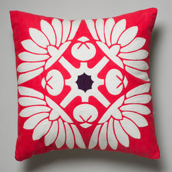 Russian Doll Cushion - Suki Cheema - This eye-catching design is part of Suki Cheema's Winter Palace collection and is inspired by prints found on traditional Russian dolls. Hand printed on sturdy cotton canvas, the flower motif is given added dimension with aari work, a traditional embroidery technique that dates back to 12th century India.