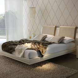 Rossetto - Diamond Ivory Bed - Queen - This perfectly designed queen size platform bed is a testament to how well the simple design efforts can present as an dramatic work of art. Diamond is a refined collection with precious new details: inserts in crocodile leather effect, inlays and components in genuine Strass Swarovski Crystals that highlight the splendor of gloss black and ivory lacquers, adding a touch of luxury to the formal elegance of this collection. Inspired by classic elements, the platform bed quietly commands attention and is sure to remain a beautiful part of your bedroom for many years.