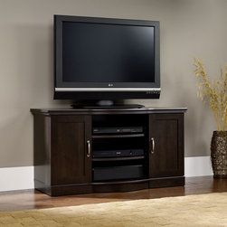 "Sauder - Miscellaneous Entertainment 47"" TV Stand - Like product from our collections, this piece is quality-build and loaded with features to meet your unique needs. Features: -Holds TVs weighing 95 lbs or less.-Storage area behind framed doors has an adjustable shelf and holds CDs and DVDs.-Two adjustable shelves hold audio/video equipment.-Front has contoured styling including the shelves.-Made in USA.-Cinnamon Cherry finish.-Miscellaneous Entertainment collection.-Recommended TV Type: Flat.-TV Size Accommodated: 47"".-Finish: Cinnamon Cherry.-Powder Coated Finish: No.-Gloss Finish: No.-Material: Engineered wood.-Solid Wood Construction: No.-Distressed: No.-Exterior Shelves: Yes.-Cabinets: Yes -Number of Cabinets: 2.-Number of Doors: 2.-Door Attachment Detail: Hinges.-Interchangeable Panels: No.-Magnetic Door Catches: Yes.-Cabinet Handle Design: Pulls.-Number of Interior Shelves: 4.-Adjustable Interior Shelves: Yes..-Scratch Resistant: No.-Removable Back Panel: No.-Hardware Finish: Silver.-Casters: No.-Accommodates Fireplace: No.-Lighted: No.-Media Player Storage: Yes.-Media Storage: Yes.-Cable Management: Cable hole.-Remote Control Included: No.-Weight Capacity: 95 lbs.-Swatch Available: No.-Commercial Use: No.-Collection: Sauder Select.-Eco-Friendly: Yes.-Recycled Content: No.-Lift Mechanism: No.-Expandable: No.-TV Swivel Base: No.-Integrated Flat Screen Mount: No.-Hardware Material: Pulls.-Non-Toxic: Yes.-Product Care: Wipe with a damp cloth.-Country of Manufacture: United States.Specifications: -ISTA 3A Certified: Yes.-CARB 2 Certified: Yes.-CARB Certified: Yes.-FSC Certified: Yes.-General Conformity Certified: Yes.-EPP Certified: Yes.Dimensions: -Base must not be larger than 47.125'' wide.-Overall Height - Top to Bottom: 25.118"".-Overall Width - Side to Side: 47.165"".-Overall Depth - Front to Back: 19.449"".-Drawer: No.-Shelving: Yes.-Cabinet: Yes.-Legs: No.-Overall Product Weight: 93 lbs.Assembly: -Assembly Required: Yes.-Tools Needed: Phillips screwdriver and hammer.-Additional Parts Required: No.Warranty: -Manufacturer provides five years warranty.-Product Warranty: 5 Years."