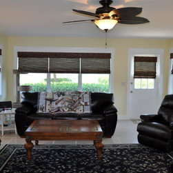 Beautiful Lined Woven Wood Shades - These beautiful lined woven wood shades made this condo livingroom! They have a continous cord loop for ease in raising and lowering. As you can see the three in one opening turned out great!