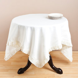 None - Vanilla Ruffled Table Topper - This simple ruffled table topper adds a touch of elegance to any room. At 60 inches square, the topper is generously sized to fit many accent tables.
