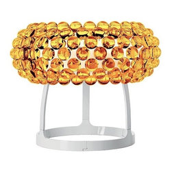 """Foscarini - Caboche Table Lamp - The Caboche collection features wall and ceiling lights and table and floor lamps composed by transparent or yellow gold spheres made of a polymethylmetacrylate shade in blown glass with a white matt finish. These table lamps create a glowing upward and downward light to brilliantly illuminate your home. This stylish and elegant Caboche collection has a unique personality that is unlike any other table lamp and will bring a contemporary look to your home.  Learn more about The Caboche Grande Table Lamp below: FEATURES 